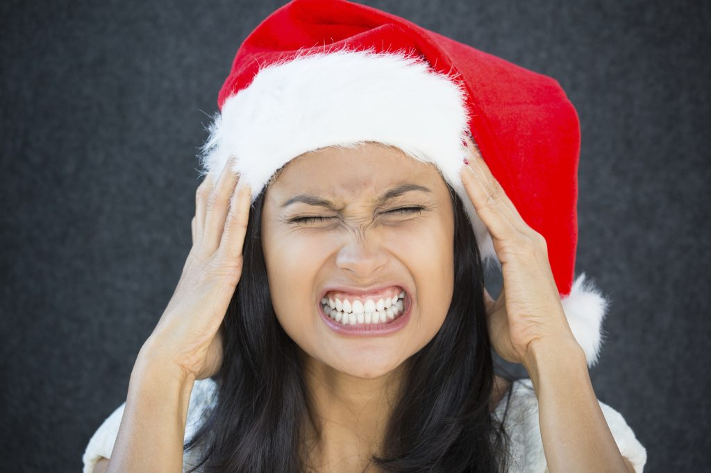 stressed woman wearing christmas hat