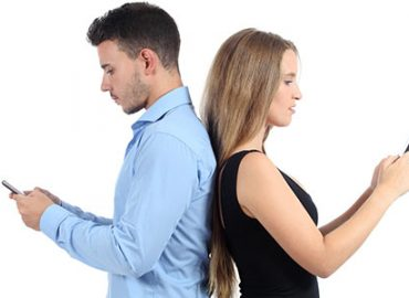 man and women being hypnotised by their phones.