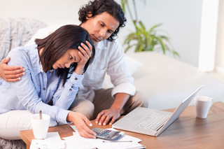 Side view of young couple having a hard time paying their bills