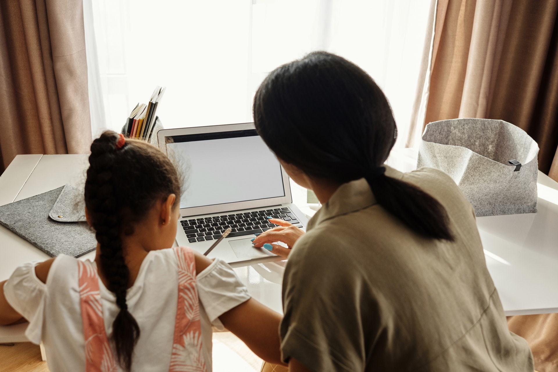 Mother helping child with psychological aid
