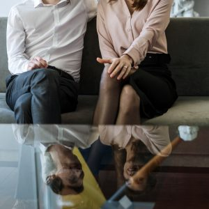 couple sitting on a couch in couples counselling session