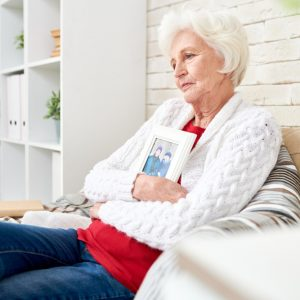 elderly woman sitting on the couch