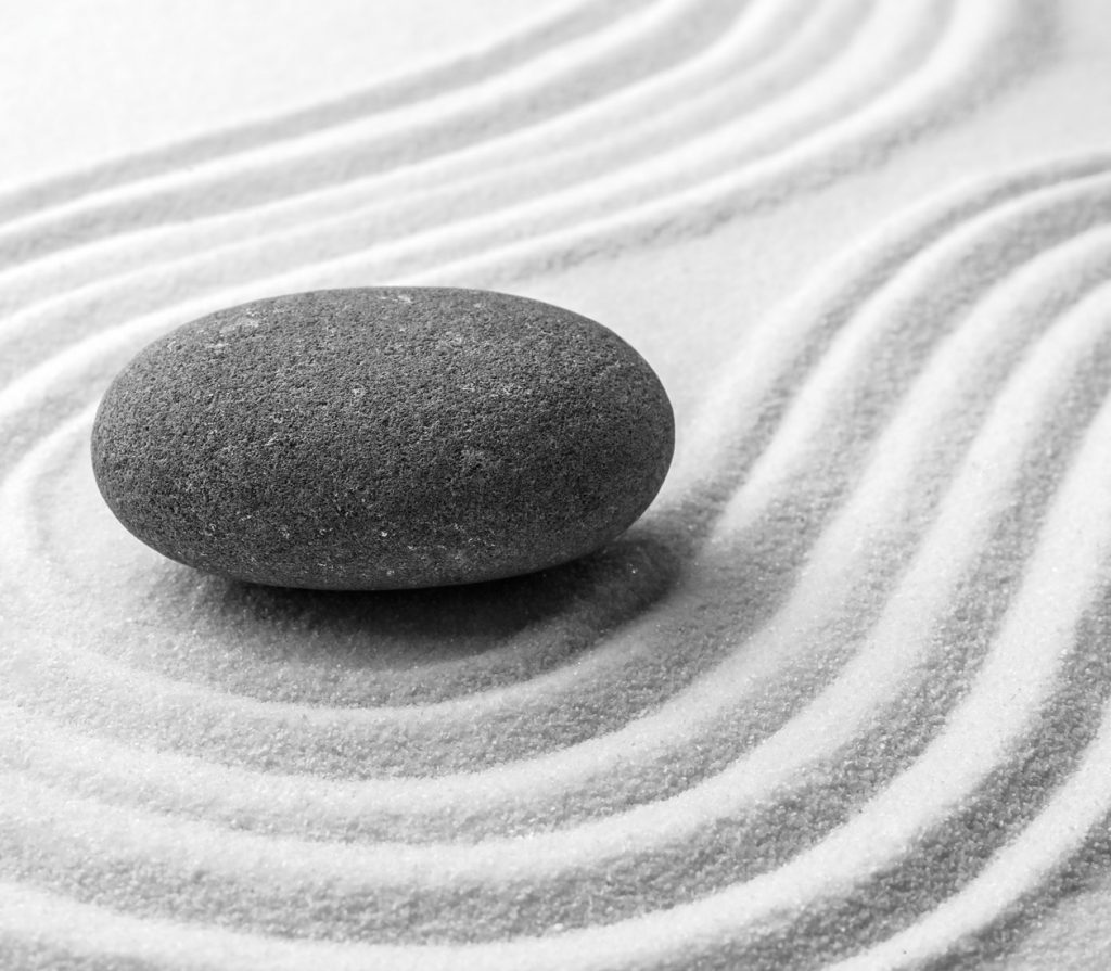 Grey stone on sand with pattern